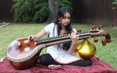 "Coppell High School junior Hira Sarangapani plays the veena; a traditional instrument from the Indian subcontinent. She rehearsed one of the songs ""Mahaganapathim"" she practiced on April 21."