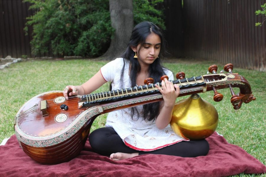 """Coppell High School junior Hira Sarangapani plays the veena; a traditional instrument from the Indian subcontinent. She rehearsed one of the songs """"Mahaganapathim"""" she practiced on April 21."""