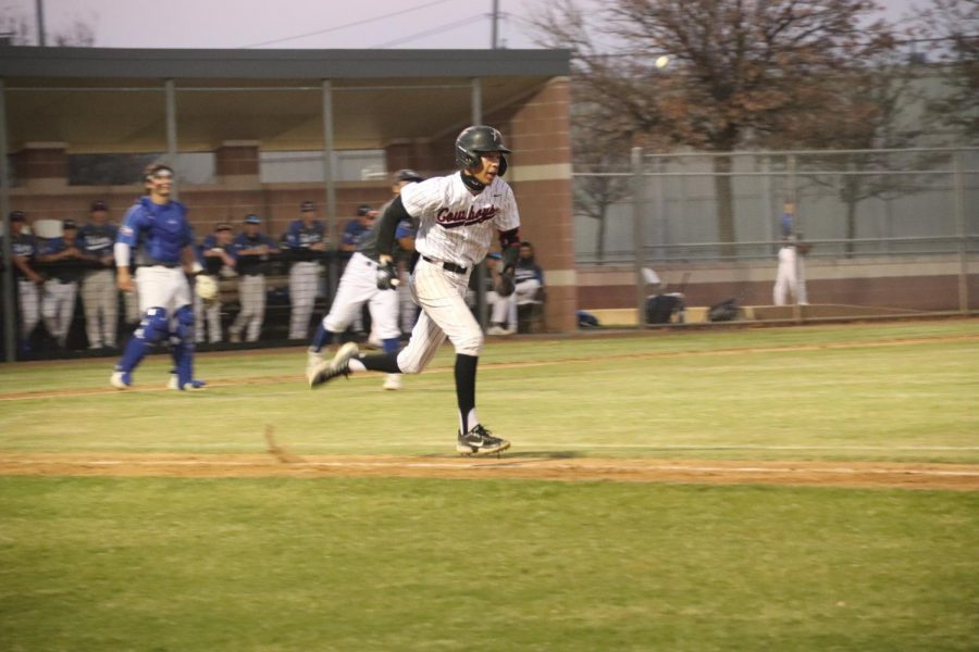 Coppell sophomore shortstop TJ Pompey runs to first against Hebron. The Cowboys beat Hebron 5-1.