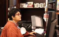 Coppell High School administrative assistant to the associate principal Veena Bhat works in her office on March 22. Bhat has worked as a library assistant and substitute teacher in the educational field, as well as with advertising for Gulf Air and American Airlines prior to her current position.