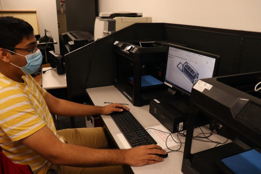 Coppell High School senior Ghufran Murtuza creates a 3D model for a CAD designing competition that will take place last Saturday for CHS Technology Student Association (TSA) club in the engineering room on Friday. More than 50 members advanced to state competitions which took place yesterday.