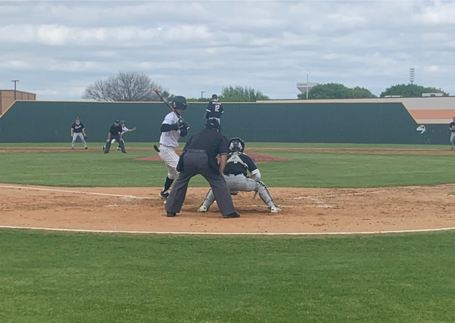 Coppell sophomore shortstop TJ Pompey hits against Plano East senior pitcher Ben Livingston. The Cowboys defeated Plano East yesterday, 9-0, at the Coppell ISD Baseball/Softball Complex.