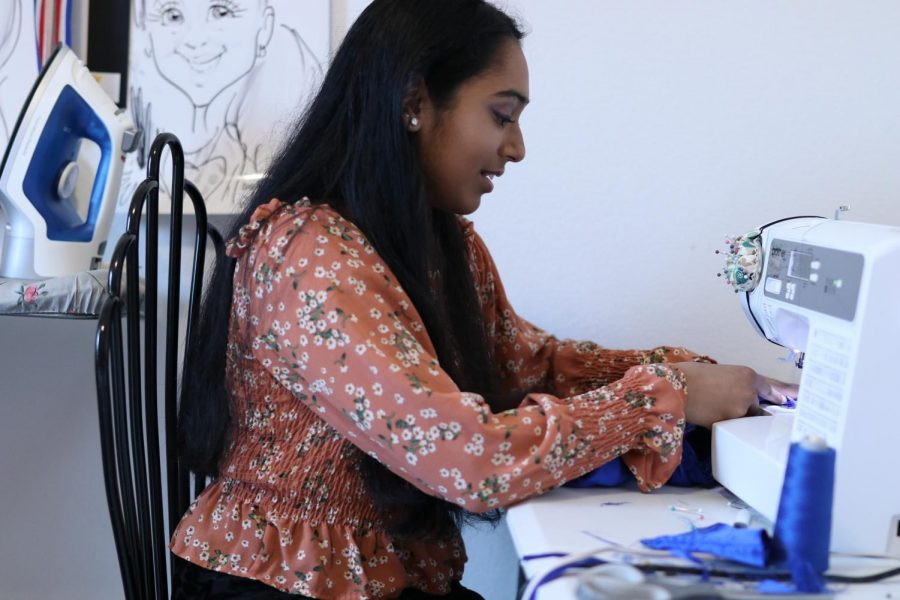 Coppell High School sophomore Mehak Lohiya designs a dress at her home on April 27. Lohiya has been designing costumes and dresses since the seventh grade.