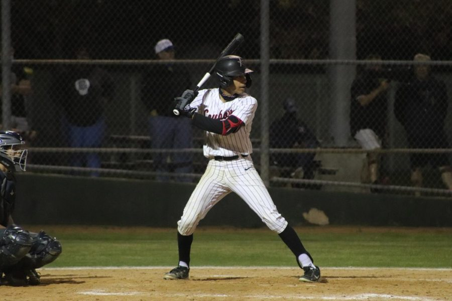 Coppell sophomore shortstop TJ Pompey hits against Flower Mound on April 27 at the Coppell ISD Baseball/Softball Complex. Pompey received a scholarship offer from Texas Tech and verbally committed in December.