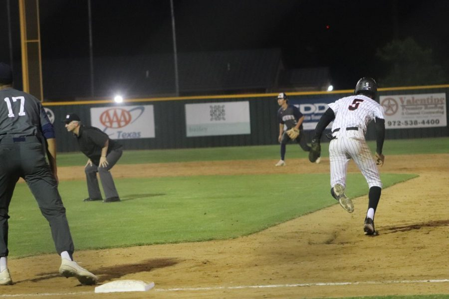 Coppell sophomore shortstop TJ Pompey runs to second against Flower Mound on April 27 at the Coppell ISD Baseball/Softball Complex. Pompey received a scholarship offer from Texas Tech and verbally committed in December.
