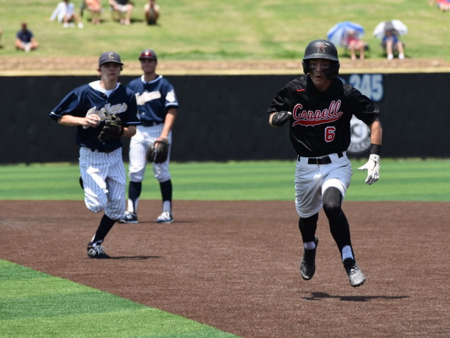 Coppell junior courtesy runner Carter Fields returns to first base in a rundown, scoring senior right fielder Will Rodman in the process against Keller yesterday at Denton Guyer. The Cowboys lost the decisive Game 3 on Saturday, 7-1, and ended their season as Class 6A Region I semifinalists after losing Game 1 on Thursday, 5-2, and winning Game 2 on Friday, 6-5.