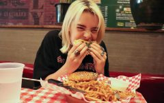 The Sidekick visual media editor Lilly Gorman eats at Chip's Old Fashioned Burgers on April 21. Gorman thinks Chip's, alongside Jakes Burgers and Big Daddy's Ship Store, has one of the best burgers despite being someone who does not often enjoy burgers.