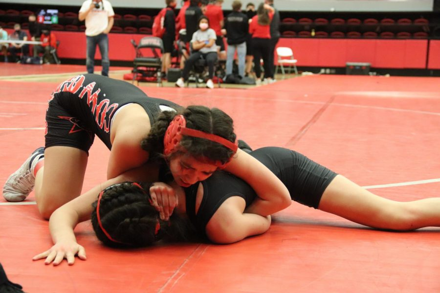 Coppell junior Kylie Fowler competes in the annual Santa Slam Meet at the Coppell High School Arena. The Coppell girls wrestling team placed ninth at the UIL State Wrestling Championships in Houston.