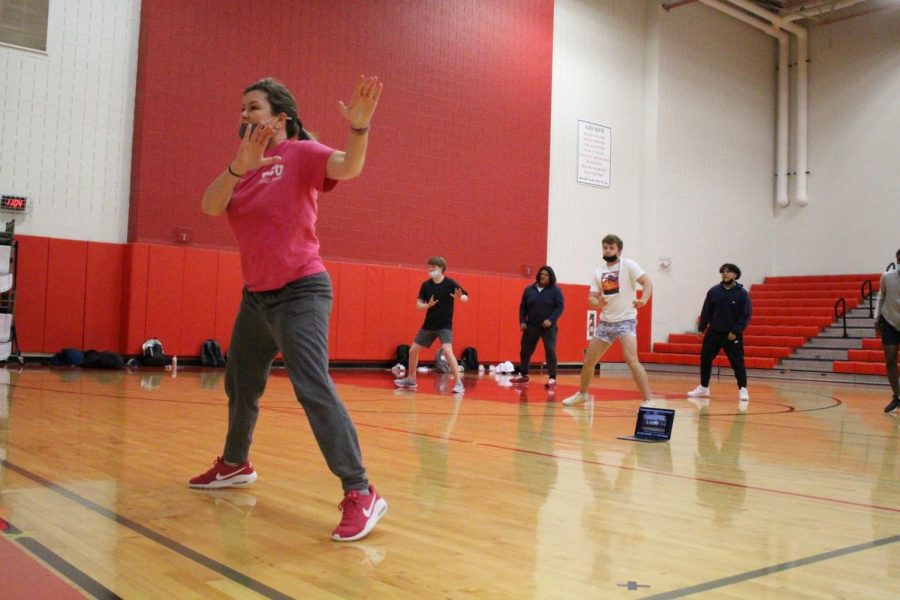 Coppell High School aerobic activities and dance I teacher Julie Stralow leads her sixth period class through aerobics warm-ups on April 23 in the small gym. Starlow was selected by The Sidekick staff as the sixth Teacher of the Issue for the 2020-21 school year.