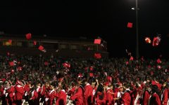 Coppell High School graduating class of 2021 participates in the traditional cap toss at Buddy Echols Field on May 28. CHS held its graduation ceremony at Buddy Echols Field on May 28. Photo by Angelina Liu