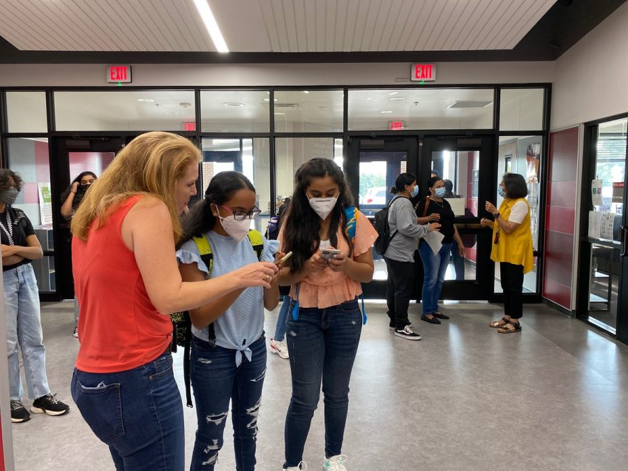 Tuesday was the first day of school in Coppell ISD. CHS9 students walk around the halls during passing period looking for their class. The building is full since there is no virtual learning option for grades 7-12 this year.