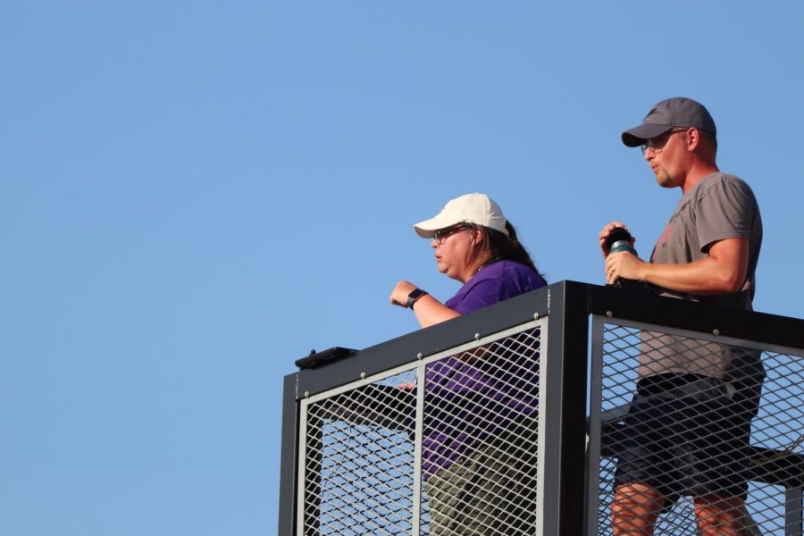 Coppell head band director Kim Shuttlesworth and color guard director Matthew Rummel conduct after school band rehearsal from atop the band director tower in the parking lot behind Buddy Echols Field on Thursday. Shuttlesworth was named the new Coppell ISD band director on April 26.
