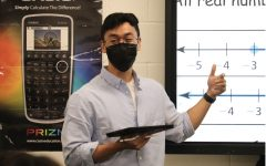 Coppell High School algebra II teacher Alec Nguyen Bui introduces characteristics of functions to his fourth period class on Monday. Bui is a new teacher at CHS and he graduated from the University of North Texas in December.