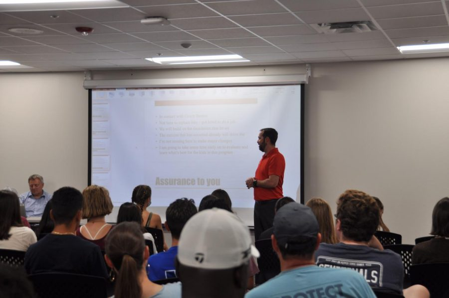 Coppell head cross country and girls track coach Landon Wren talks about his goals for the 2021-22 season at a coach meet and greet last Tuesday in the Field House. Last Tuesday, Wren was announced to be the replacement for Nick Benton, who resigned in early July.