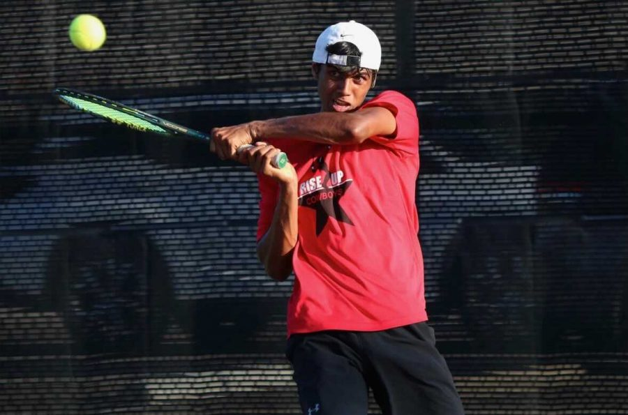 Coppell senior Vinay Patel hits a backhand against Dallas Jesuit sophomore Alex Park on Friday at the Coppell High School Tennis Center. Coppell Tennis defeated Dallas Jesuit and Ursuline Academy with a combined score of 15-4.