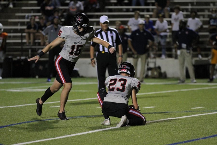 Coppell junior kicker Nic Radicic kicks an extra point after Coppell senior wide receiver Dylan Nelson's 56-yard touchdown reception during the fourth quarter at Homer B. Johnson Stadium in Garland on Friday. The Cowboys defeated the Mustangs, 42-28, in their season opener.