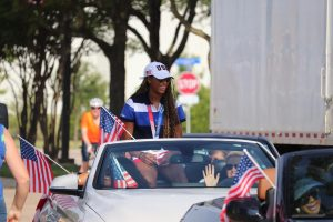 Coppell High School alumna and Olympian Chiaka Ogbogu arrives at the start of the parade surrounded by her family. Ogbogu is the first Olympian from Coppell and won gold alongside the U.S. Olympic women's volleyball team.