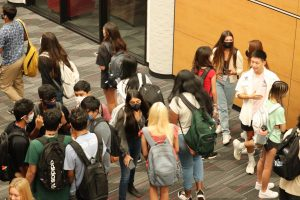 Coppell High School students greet each other before first period on the first day of school on Tuesday. All CHS students are on campus for the first time since March 2020.