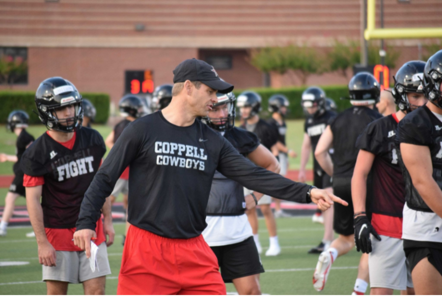 Coppell coach Michael DeWitt instructs the defensive backs during a footwork drill on Aug. 10 at Buddy Echols Field. The Cowboys play Sachse tomorrow night at 7 p.m. for their season opener at Homer B. Johnson Stadium in Garland.