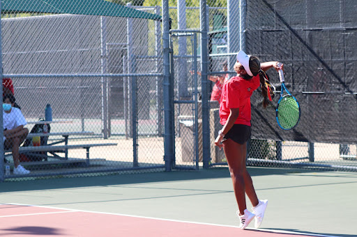 Coppell junior Lakshana Parasuraman serves against Plano during a doubles girls match on Tuesday. The Coppell tennis team defeated Plano, 17-2.