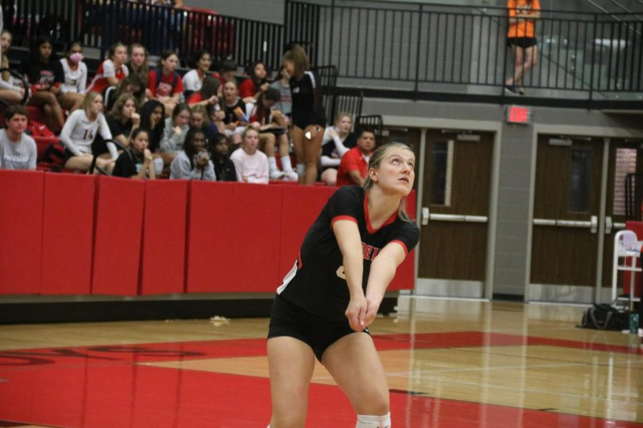Coppell senior defensive specialist/outside hitter Haley Holz digs against Lewisville during the volleyball match last night in the CHS Arena. Taking the lead in all three sets, the Cowgirls brought home a big win 3-0 (25-12, 25-11, 25-17) for Senior Night.