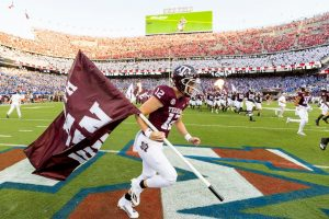 Texas A&M deep snapper Connor Choate runs the flag for the Aggies against Kent State on Sept. 4 at Kyle Field. Choate, a Coppell High School 2017 graduate, was named as the 12th Man for this year on Aug. 28.