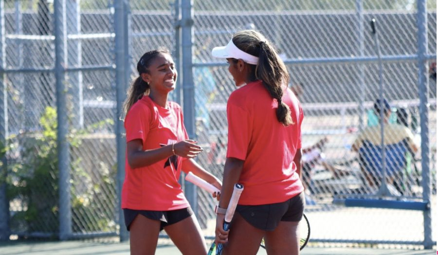 Coppell senior Nandini Thallapareddy and junior Lakshana Parasuraman celebrate a volley against Ursuline Academy at the CHS Tennis Center on Aug. 20. The Coppell tennis team defeated Dallas Jesuit and Ursuline Academy with a combined score of 15-4.