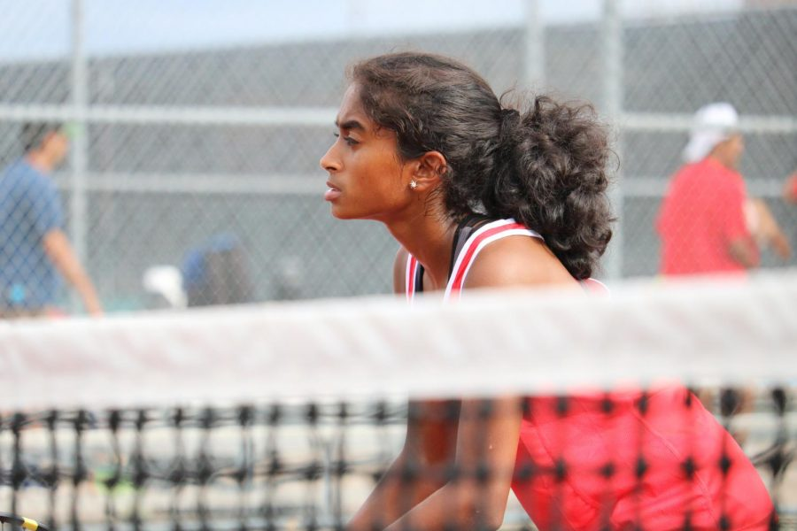 Coppell sophomore Zahra Shaikhali waits for Hebron's serve during a doubles match on Tuesday at the Coppell Tennis Center. Coppell defeated Hebron, 16-3, bringing its district record to 2-2. Photo by Olivia Cooper