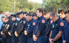 Coppell police officers and firefighters bow in remembrance of the lives lost on Sept. 11, 2001, at the Patriot Day Ceremony at the Coppell Town Center on Friday. Saturday is the 20th anniversary of terrorist attacks which took down the World Trade Center towers in New York City, as well as hijacked planes which crashed into the Pentagon and in Pennsylvania.