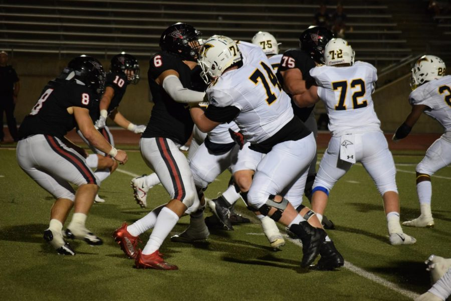 Coppell senior defensive lineman Carlos Maldonado defends against Plano Prestonwood Christian Academy in the third quarter on Friday at Buddy Echols Field. The Cowboys host Highland Park in the final nondistrict game tomorrow at Buddy Echols Field, with kickoff at 7 p.m.