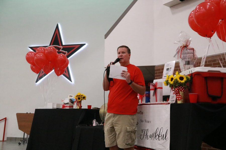 Coppell ISD Superintendent Dr. Brad Hunt announces raffle ticket winners at the Lariettes Spaghetti Dinner in the CHS Commons on Friday. The Lariettes Spaghetti Dinner is an annual tradition that features a catered meal, baked goods and a raffle for various prizes.