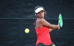 Coppell junior Lakshana Parasuraman returns a ball in her singles match in Coppell's match against Hebron at the Coppell Tennis Center on Tuesday. The Coppell tennis team defeated Hebron 16-3.