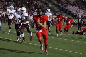 Coppell junior quarterback rushes in for a touchdown during the first quarter against Plano at Buddy Echols Field last night. The Cowboys defeated Plano, 35-13, in their first District 6-6A clash.