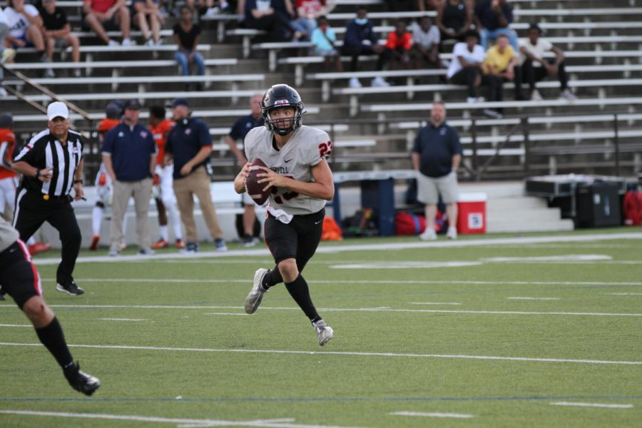 Coppell junior quarterback Jack Fishpaw looks for an open man downfield against Sachse on Aug. 27 at Homer B. Johnson Stadium in Garland. The Cowboys host Prestonwood Christian Academy on Friday at Buddy Echols Field for their home opener, with kickoff at 7 p.m.