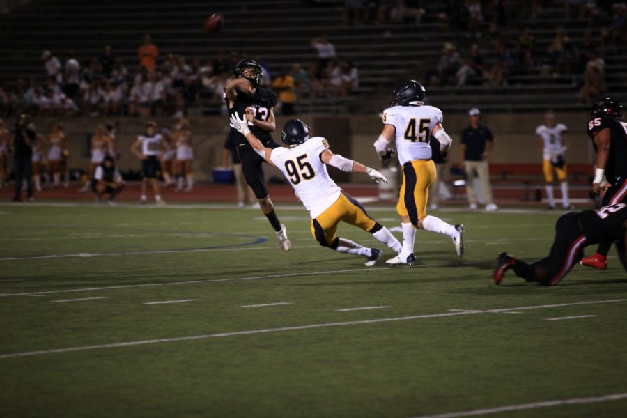Coppell junior quarterback throws it away to escape defensive pressure from Highland Park senior defensive lineman Jack Curtis on Friday at Buddy Echols Field. Coppell fell to Highland Park, 28-13, in its last nondistrict game.
