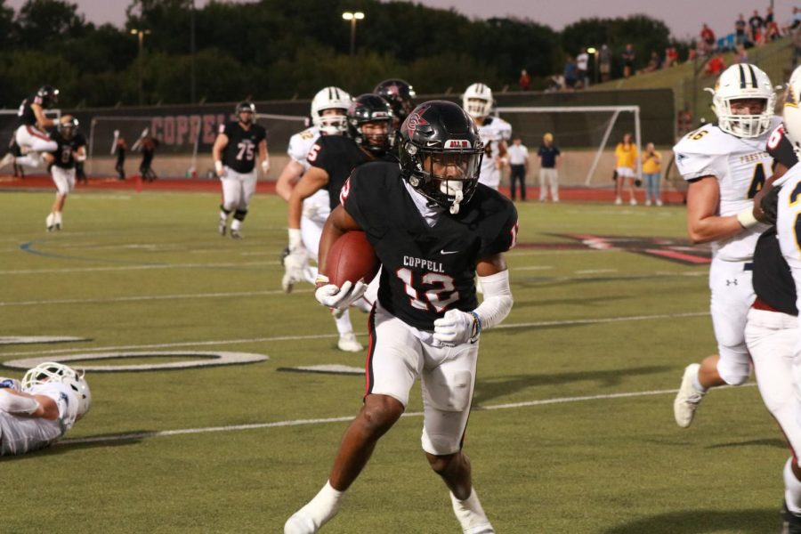 Coppell senior running back Dylan Nelson takes a 39-yard fake punt on fourth and 1 against Prestonwood Christian Academy during the third quarter at Buddy Echols Field on Friday. The Lions defeated the Cowboys, 55-41.