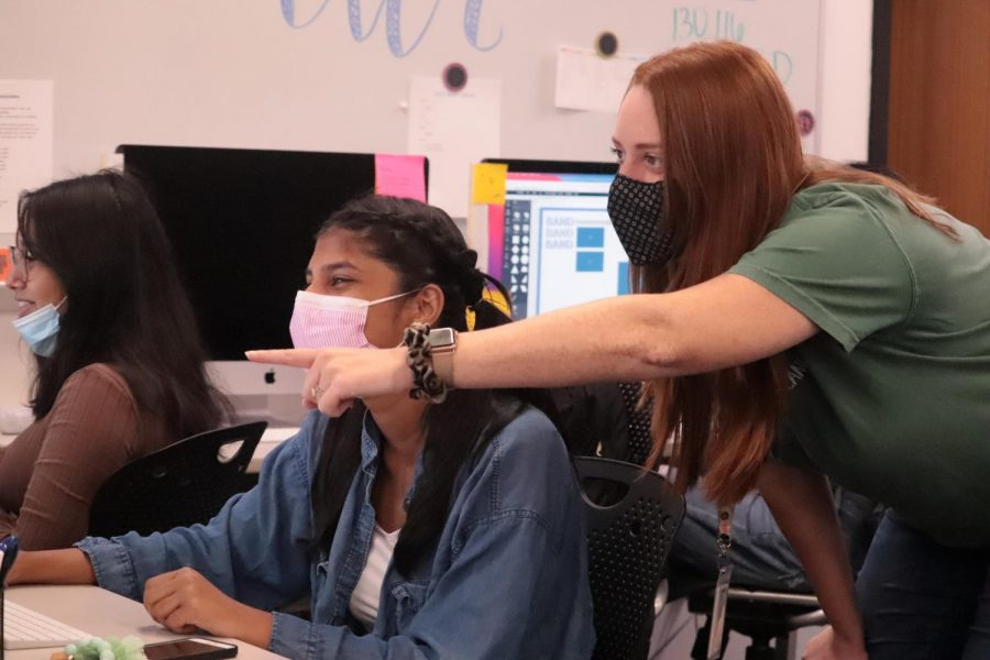 Coppell High School Round-Up adviser Jenna Grinnan helps CHS senior Round-Up editor-in-chief Ilene Thomas edit a page design during first period on Sept. 2. Grinnan is a new teacher at CHS and previously worked at CHS9 as the Principles of Arts and A/V Tech teacher for three years.