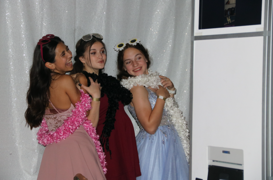 Coppell High School freshmen Christian Reyes, Rebekah Liebert and Sophie Hart take photos at the photo booth last night at the CHS Arena. Unlike previous years, this year's homecoming dance is hosted in the school arena.
