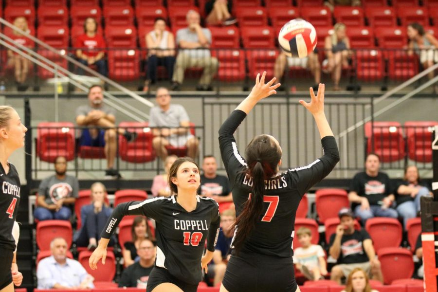 Coppell junior setter Taylor Young sets to junior middle hitter Allie Stricker against Marcus at the CHS Arena on Tuesday. Coppell volleyball lost to Marcus, 3-1 (25-20, 25-21, 25-21, 30-28). Photo by Olivia Short.