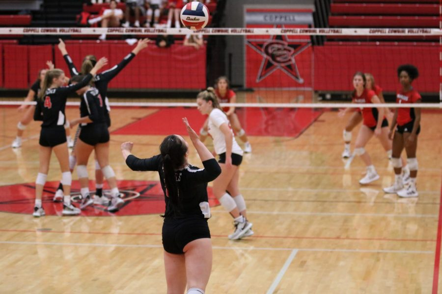 Coppell junior setter Taylor Young serves against Marcus at CHS Arena on Tuesday. The Cowgirls fell to the Marauders, 3-1 (25-20, 25-21, 25-21, 30-28).