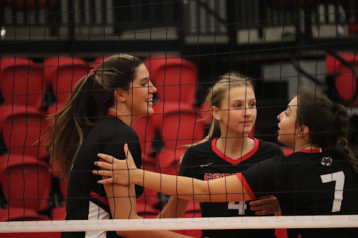 Coppell junior outside hitter Sky Lamendola and senior right side hitter Abby Hendricks congratulate senior middle hitter Aley Clent after a kill against Plano at the CHS Arena on Friday. The Cowgirls defeated Plano, 3-0 (25-13, 25-16, 25-21).. Photo by Olivia Short.