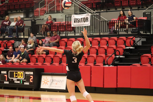 Coppell Junior defensive specialist Karissa Cameron serves against Plano on Sept. 28. The Cowgirls host Plano West tonight at the Coppell High School Arena, starting at 6:30 p.m.