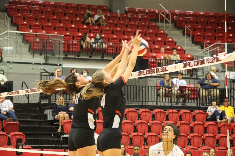 Coppell senior middle blocker Aley Clent and junior outside hitter Skye Lamendola block against Flower Mound at the CHS Arena on Friday. The Jaguars swept the Cowgirls, 25-20, 25-20, 25-20. Photos by Trisha Atluri