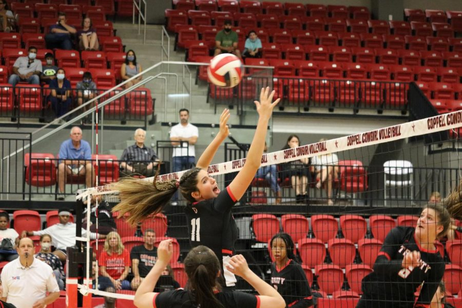 Coppell senior middle blocker Aley Clent blocks against Euless Trinity at the CHS Arena on Tuesday. The Cowgirls swept the Trojans at Middle School Night, 25-11, 25-21, 25-10.