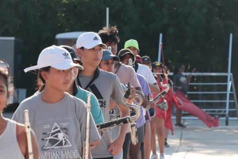 Coppell High School Band practices choreography in the parking lot behind Buddy Echols Field during its after school rehearsal on Aug. 26. Coppell Band and other fine arts is adjusting to in-person learning after a year of Zoom practice sessions. Photo by Olivia Cooper