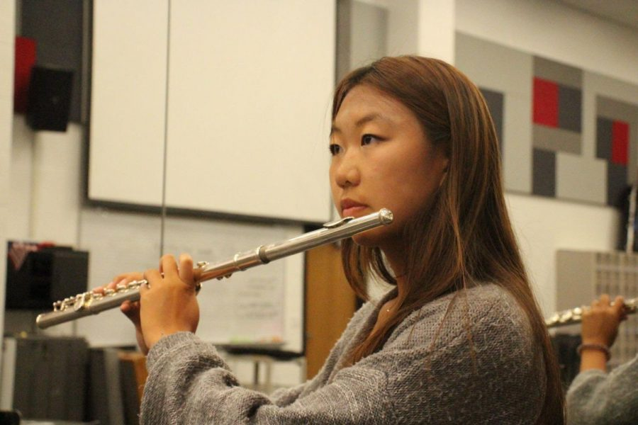 Coppell High School sophomore flutist Lindsey Won prepares for a recital during seventh period in the CHS Band Hall on Sept. 4. Won placed first in The Golden Classical Music Awards competition, qualifying her to play at Carnegie Hall next July. Photo by Aliza Abidi.