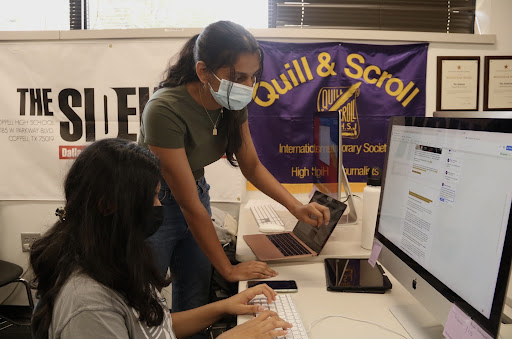 Coppell High School senior executive editor-in-chief Anjali Krishna assists senior executive editorial page editor Sreeja Mudumby with copy editing in D115 on Sept. 7. Krishna expresses how finding her place in The Sidekick allows her to find gratification in her work.