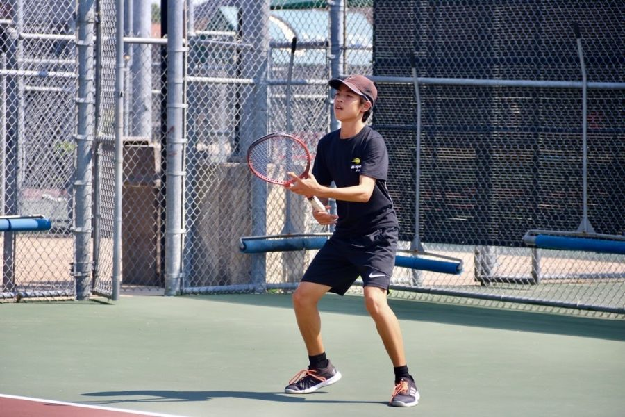 Coppell tennis starter Riki Koshimizu warms up for practice on Thursday during fourth period. Koshimizu has been on the Coppell tennis team since his freshman year on JV1 and moved up to varsity within a year.
