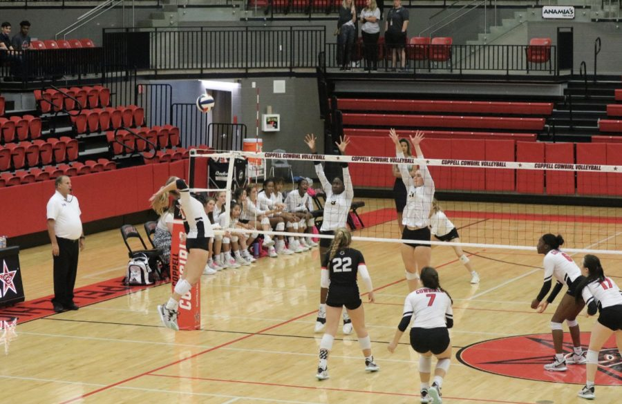 The Coppell volleyball team gets into formation against Plano East at the CHS Arena on Friday. Coppell volleyball won against Plano East, 3-0 (25-23, 25-22, 25-13).