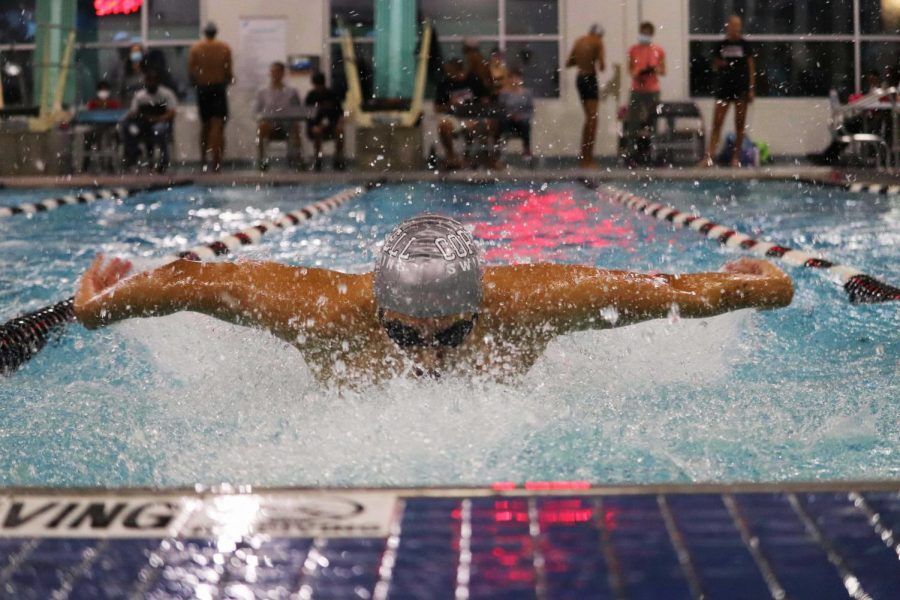 Coppell varsity sophomore swimmer Sean Li competes in the men's 100-meter breaststroke at the Coppell Family YMCA on Monday. The annual Vaquero Battle returned from a year of hiatus featuring a cannonball competition and fun student/teacher games.